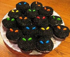 Creepy cupcakes - use  crushed oreos for frosting and m&m's for the eyes.