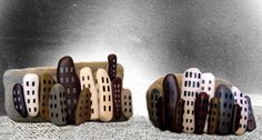 little cities - painted rocks - a collection of long pebbles painted to look like city skyscrapers.