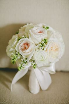 All white wedding bouquet with roses.