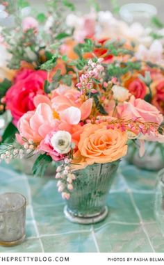 Selection of soft pink & peach table flowers | Photography: Pasha Belman Photography, Flowers & Decor: Blossoms Events