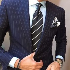 Stripes on the suit and the tie, dots on the pocket square:...