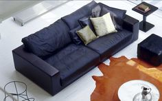 Design: Paola Navone Modern, Specular Design, The Contrast Of Leather  Between Body And Pillows Or The Softnesses Of The Leathers Plume Is Great:  It Is