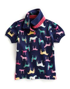 Joules JNR LENA Girls Short Sleeve Polo, Navhrse. Pretty in prints. Our country heritage inspired prints are one way to stand out from the crowd.