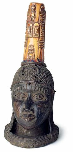 Two Heads with Ivory Benin, Nigeria 18th/19th century Bronze 60 and 61 cm