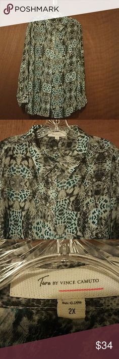 Vince Camuto animal print blouse Beautiful Vince Camuto animal print blouse. Black gray Bluegreen and white. Buttons down the front has a pocket in the front and buttons at the cuffs. 100% polyester,  beautiful shirt nice and flowy, sheer. Vince Camuto Tops Button Down Shirts