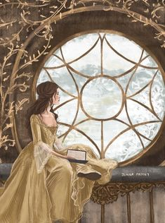 Belle by the window in the castle with her book
