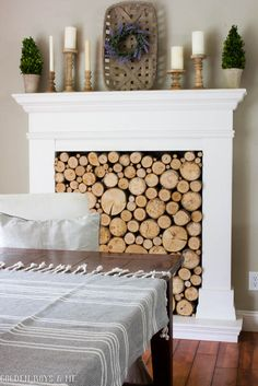 DIY faux fireplace with stacked wood and tobacco basket mantel decor