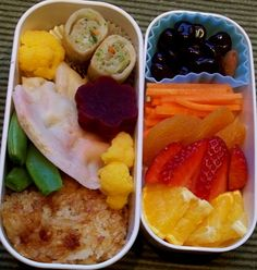 Bentos for the adults today. Same stuff, different arrangements. Chicken veggie dumplings and spring rolls. My first attempt at yaki onigiri (I used the wrong kind of rice and they fell apart :( ), deviled eggs (mine had a side car), steamed snow peas, orange cauliflower & beet flowers. Matchstick carrots,strawberries, oranges and grapes. This was a very satisying bento. :)