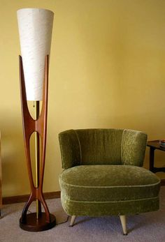 Mid century modern floor lamp slender and sculptural teak design with one socket with a three way brass pull chain