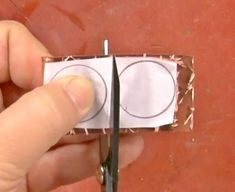 adhere patterns to metal with rubber cement or glue stick - from Master Riveting with Kim St. Jean's New Video Tutorials, Part 2: 8 More Essential Metalsmithing Tips - Jewelry Making Daily