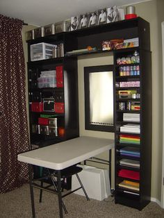 excellent way to have a craft area in a small space....  Stack 3-4 cubes vertically???  Tuck sewing table up against window... more space in center of room?