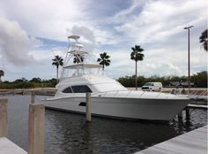 This Bertram 64 is docked for outfitting with its Pipewelders Tower and HST Electronics before delivery! #sportfishing #yacht