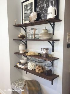 Easy DIY shelves can fill an empty wall space in the kitchen. Just stack extra plates, dishes and other seasonal decor for a pretty display. Not only do they provide extra storage, but the decor is easy to change for each new season too. Sponsored by HomeGoods.