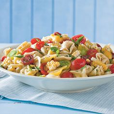 Tortellini-and-Tomato Salad Recipe | Fresh heirloom tomatoes brighten pasta salad  tossed with cheese-filled tortellini, green onions, herbs, and a vinaigrette.