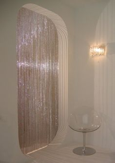 Lush beaded curtain and curved walls.