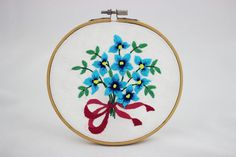 embroidery hoop picture  hoop art  hand embroidered wall hanging with blue flowers / floral wall decor, pink ribbon