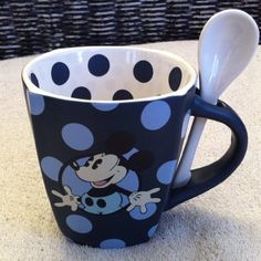 Disney Park Mickey Mouse Blue Polka Dot Mug w Spoon, http://www.amazon.com/dp/B005HS9YV6/ref=cm_sw_r_pi_awdm_oLsPwb0R9QW9F