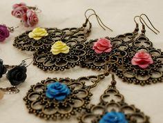 Paper flowers earrings by Catarina Coelho