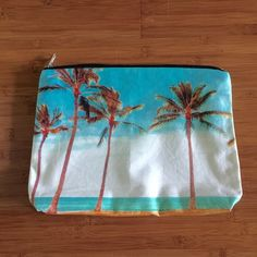 Samudra clutch/pouch Maili palm tree NWOT Samudra clutch/pouch Maili palm tree NWOT. Samudra usually don't come with tags attached. This is a brand new never used clutch. Beautiful! Fits iPad, swimsuits and sunscreen, book, or whatever! Samudra Bags Clutches & Wristlets