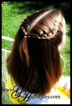 French braid crown.  I think her hair is almost long enough to do this one again.  From Girly Do's By Jenn