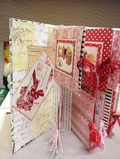 """My new special Valentine mini album made by using two-sided paper from Authentique's collection; """"Lovely"""".  It has a hard cover and 8 pockets with pull-out cards.  I wrote love poems on the back of each card and intend on putting a photo on the front of each card."""