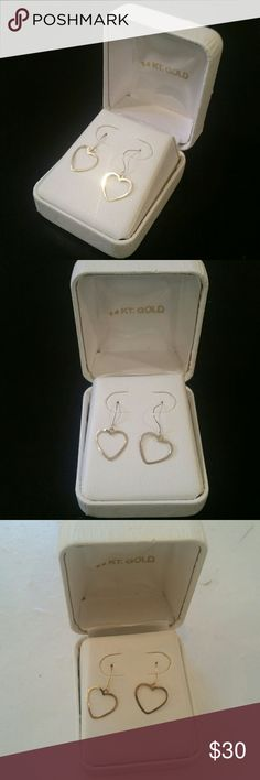 NEW 14k gold heart earrings Never worn! 14k gold heart drop dangle earrings. Appear silver in some lighting but they are a very light gold, rest assured :) Comes in original box that has some markings / wear from storage unfortunately. Open to offers & LOVE giving a great bundle discount! Jewelry Earrings