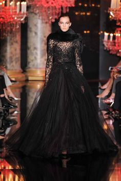 Elie Saab Fall 2014: I love the drama and elegance of this gown! The fur neck pieces adds drama!