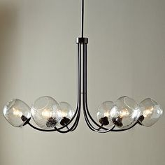Trying to find a non-typical mid century chandelier for my dining room. What do you think?  Eclipse Chandelier #WestElm