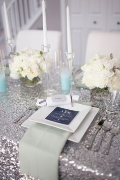 #Tiffany Blue Wedding ... Glitter table linen, simple flowers and tiffany blue candles... we would swap the pistachio napkins for more baby blue...