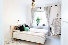 Bedroom with decorative elements taken from a Swedish apartment.  Light, soft and cozy~!