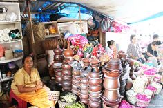 A potteries shop and its owner, at Beringharjo Traditional Market.