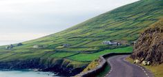 Dingle Bay Ireland.  This is an actual two way road with all signs in Gaelic and sharing the road with sheep and cows.  Quite the experience but well worth it.