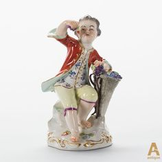 """The figure """"Boy with grapes"""". Sign of the the manufacturer is """"Meissen""""."""