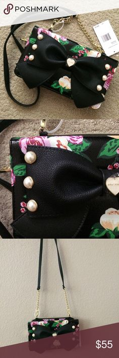 """Betsey Johnson black floral crossbody pearl bow What a gooooorgeous bag!!!  Classic black with gold hardware, plus vibrant flower print and a statement large bow with pearls!  Amazing!  9.5"""" by 5.5"""" by 1.5"""", strap drop 23"""".  Strap is removable (can use as clutch!) but not adjustable.  NWT! Betsey Johnson Bags Crossbody Bags"""