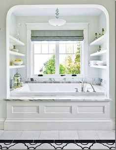 bath cove w/ open shelving, lip to rest toiletries, faucetry at easy access