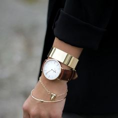 Cuffed sleeves and stacked Jewelry. Street style
