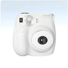 Fuji Instant Camera-  The Polaroid is back!  A woman had one in the Maldives.  Looked so fun!