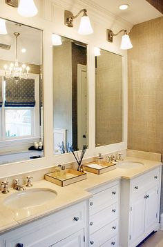 Elsa Soyars: Custom bathroom with double vanity and burlap wallpaper. White recessed panel cabinets ...