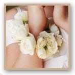 Flowergirl bracelet of ivory mini roses, pearl strings and diamontes