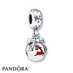442d068cf Prancing reindeer in red enamel encircle a round sterling silver dangle  topped with a ribbon and