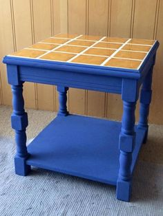 Blue side table with yellow tiles and concealed lighting