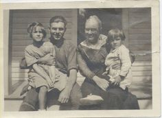 Ernest Hemingway holds his sister, Carol, while his mother Grace holds Leicester, his brother.