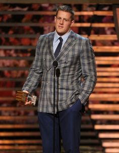 J.J. Watt, of the Houston Texans, accepts the AP defensive player of the year award on stage at the 4th annual NFL Honors at the Phoenix Convention Center Symphony Hall on Saturday, Jan. 1, 2015. (Photo by Frank Micelotta/Invision for NFL/AP Images)