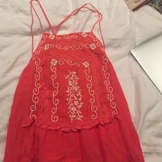 Orange Free People top! Fits normally, not oversized. Free People Tops
