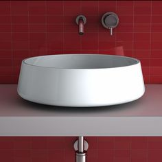 This ultra modern round white luxury vessel sink employs a special brush technique in order to obtain a bi-chromatic effect. The board is also brushed and polished by hand to enhance the soul and color. The round and clean design will look perfect sitting right on top of the bathroom vanity of your elegant powder room, and with light and dark colors to choose from, you will have to make no style compromises.
