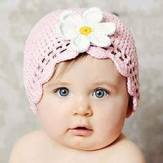 Pink Crocheted Baby Hat with White Flower