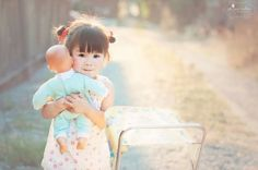 cute girl and doll