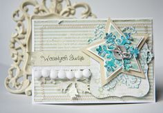 handmade Christmas card ... shabby chic style ... layered main element with die cut stars, snowflake, button & string ... soft wintery colors ...