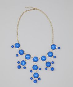 Love the bubble design for summer swimsuit.     Smooth sailing in style. This Lucite bubble necklace showcases high fashion inspired by the high seas.     20'' long with 2'' extender  Drop: 4'' long  Lucite / gold electroplated  Imported
