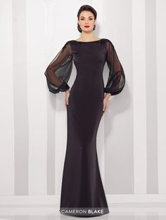 Cameron Blake 216680 - Stretch crepe and chiffon sheath features billowing illusion chiffon long sleeves with slit and cuffs, hand-beaded shoulders, bateau neckline, curved V-back.